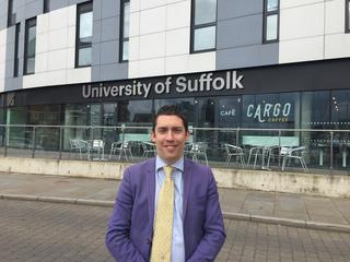 Adrian outside University of Suffolk