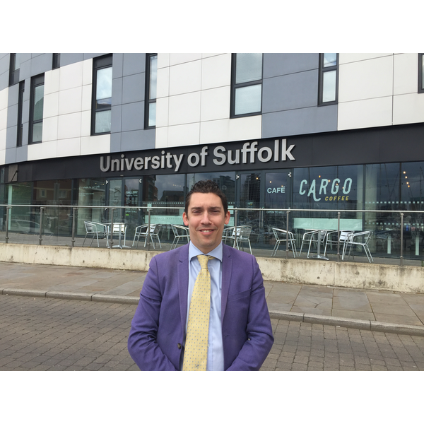 Adrian outside University of Suffolk